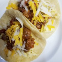 Breakfast tacos with eggs, chili, & cheese.LPC